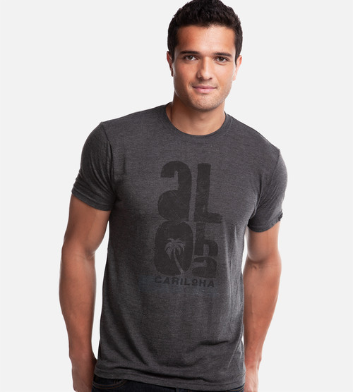 front view of model wearing charcoal comfort crew tee with brushed aloha design