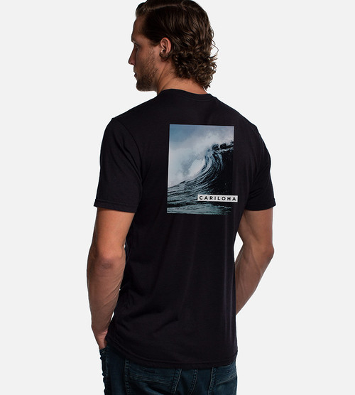 back view of model wearing wave back graphic tee