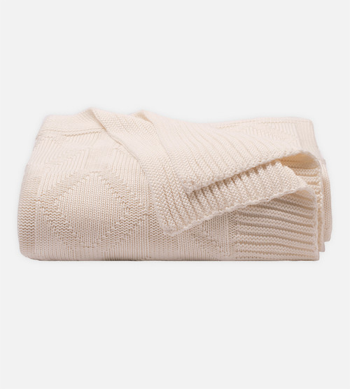 side view of Diamond Coconut Milk knit throw