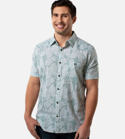 front view of model wearing ocean green foliage print button up shirt