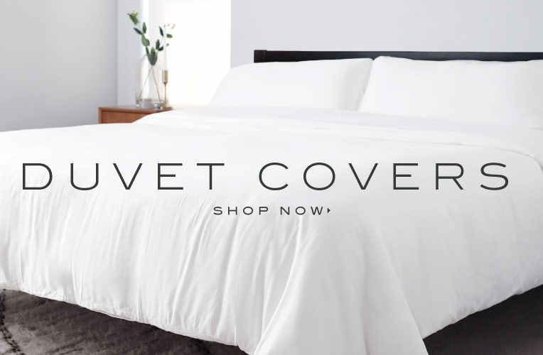 corner shot of a bed feature cariloha duvet cover