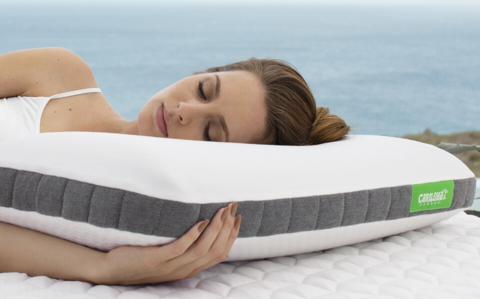 Woman rest laying on bamboo pillow