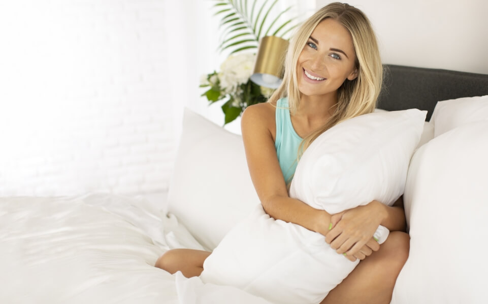 Woman holding a bamboo pillow