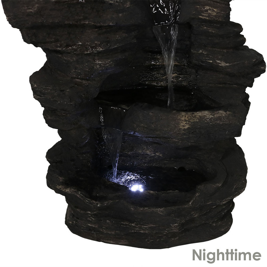 Bottom Nighttime View of Rock Falls Electric Waterfall Fountain with LED Lights