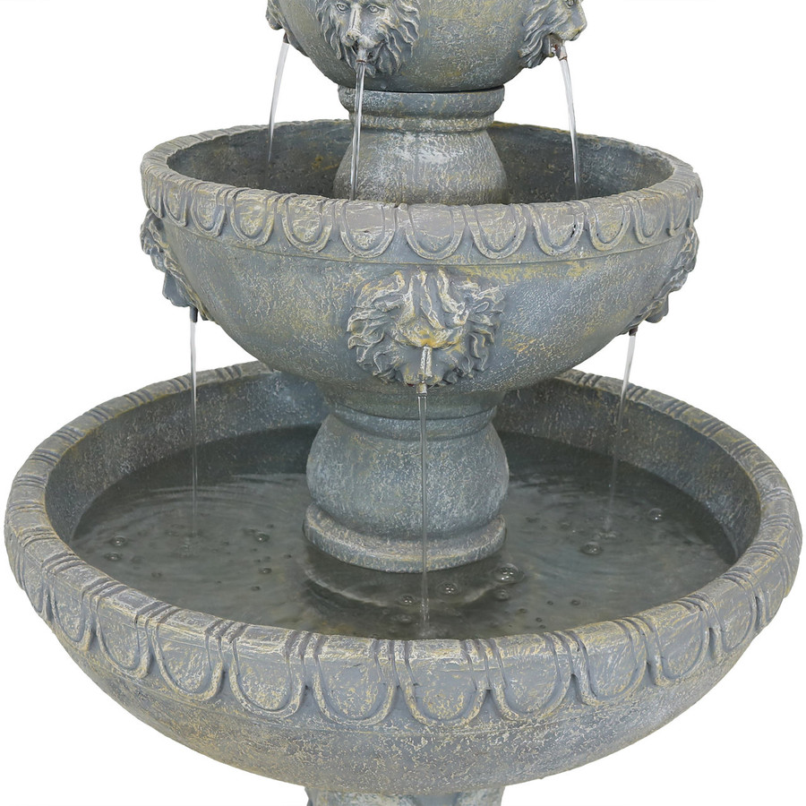 Closeup of Four Tier Lion Head Outdoor Water Fountain