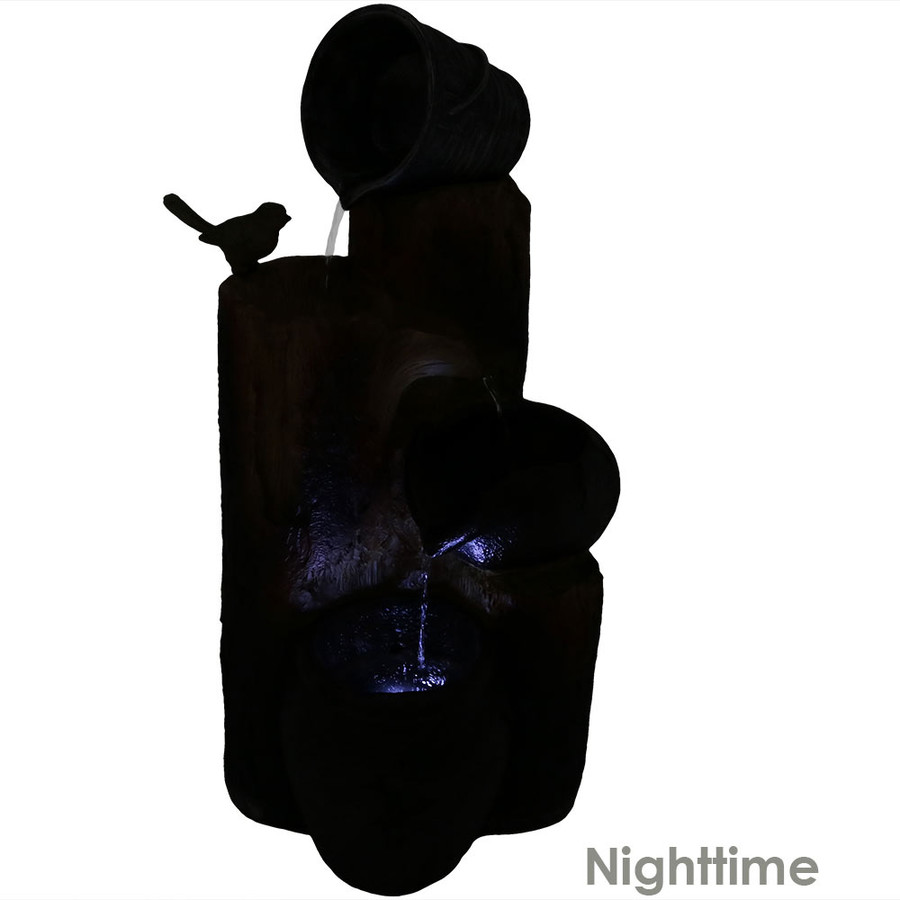 Nighttime View of Cascading Log and Buckets Fountain