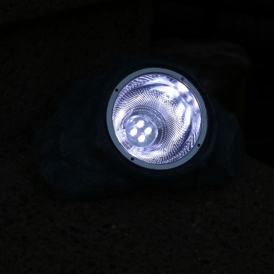 Small Rock With White Solar LED Light Nighttime View