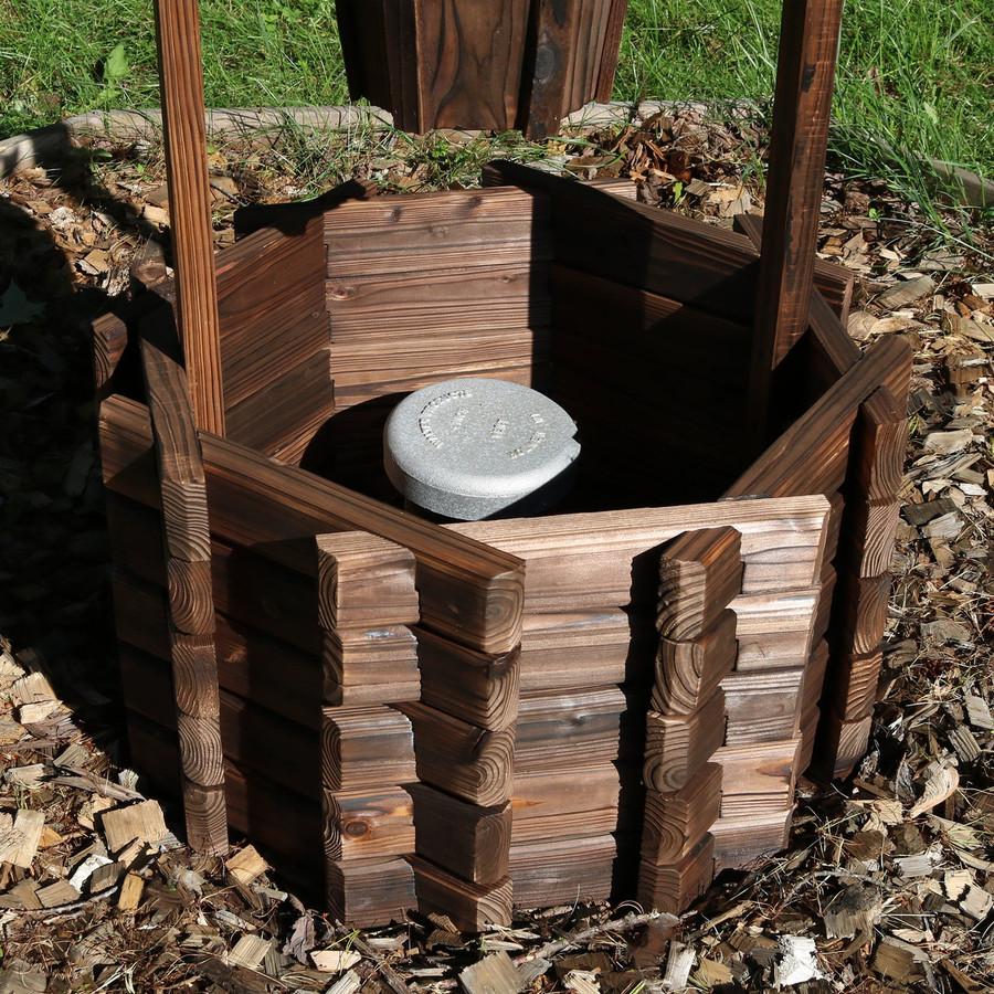 Bottom of Wood Wishing Well Outdoor Garden Planter Covering a Pipe
