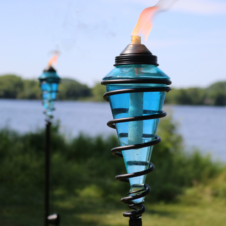 Closeup of Metal Swirl with Blue Glass Outdoor Torches