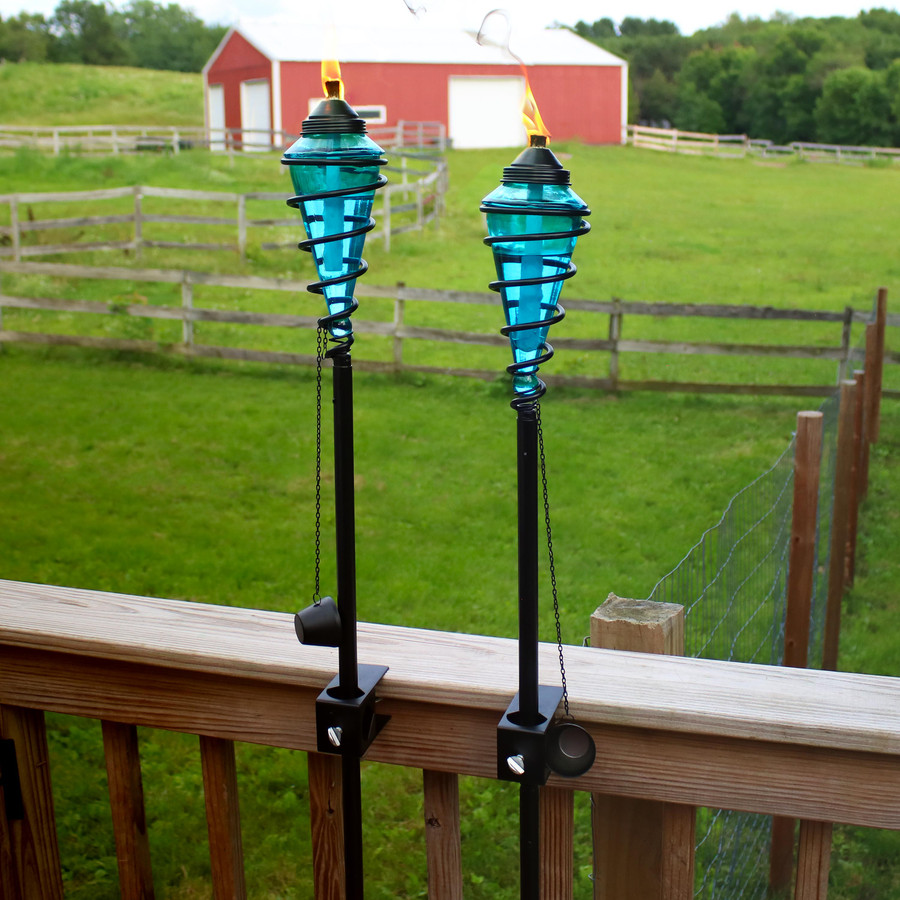 Blue Glass Outdoor Torches Mounted on Deck Rail