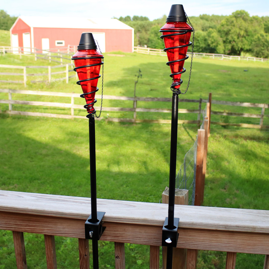 Red Glass Outdoor Torches Mounted on Deck Rail