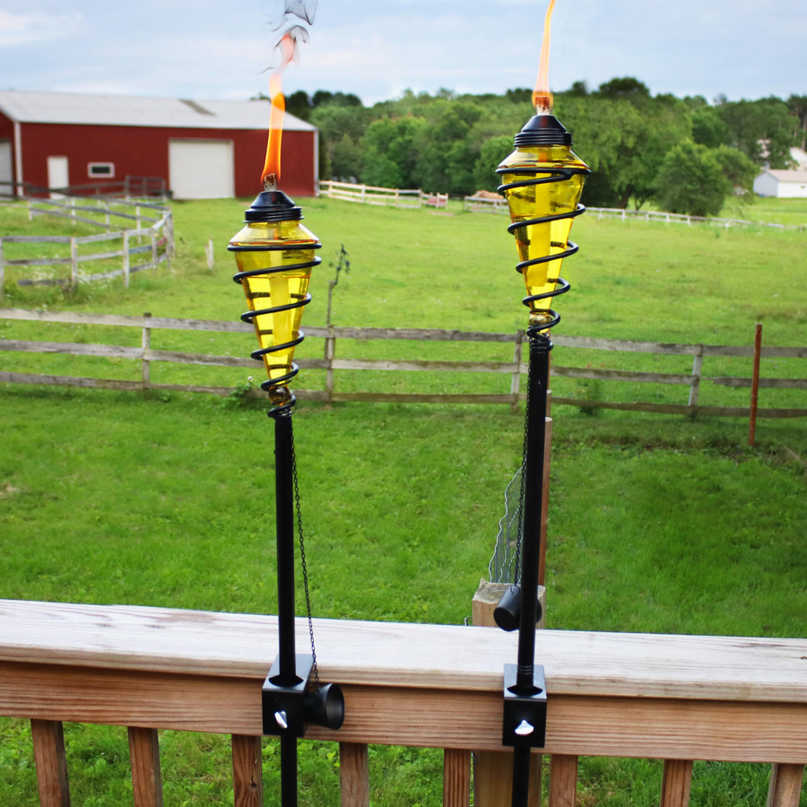 Yellow Glass Outdoor Torches Mounted on Deck Rail