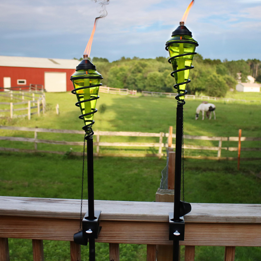 Green Glass Outdoor Torches Mounted on Deck Rail
