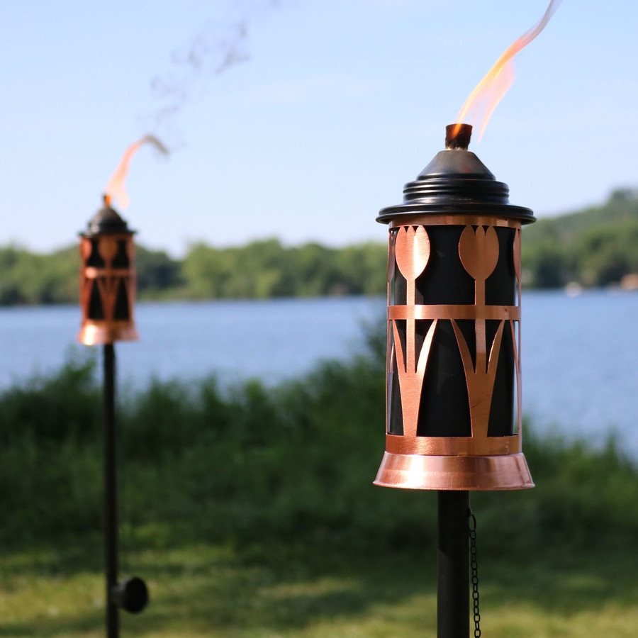 Closeup of Copper Outdoor Torch with Tulip Jar Design