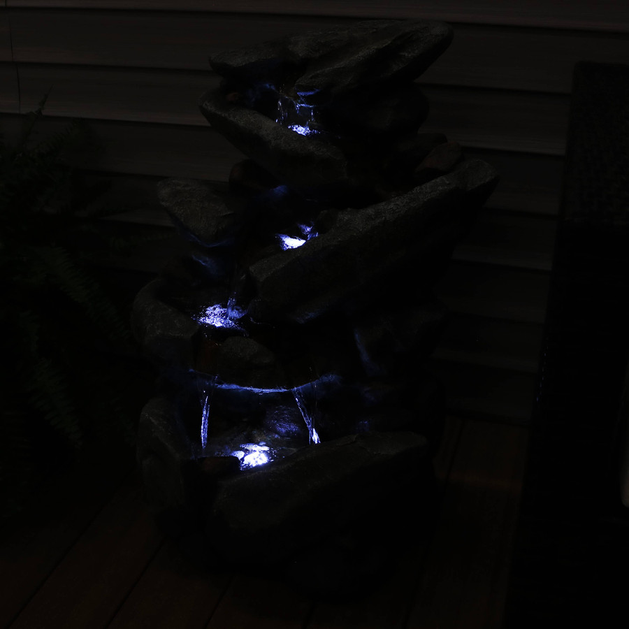 Streaming Tilted Rocks Outdoor Water Fountain, Nighttime