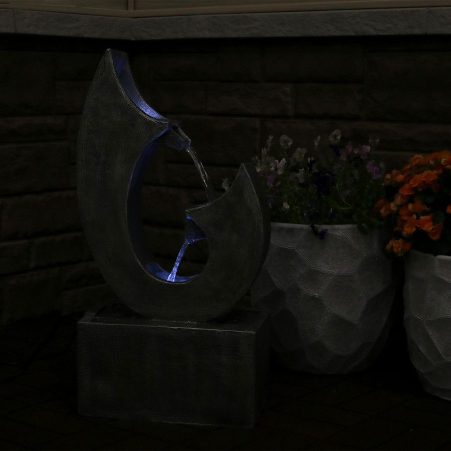 Modern Flowing Curves Outdoor Water Fountain, Nighttime
