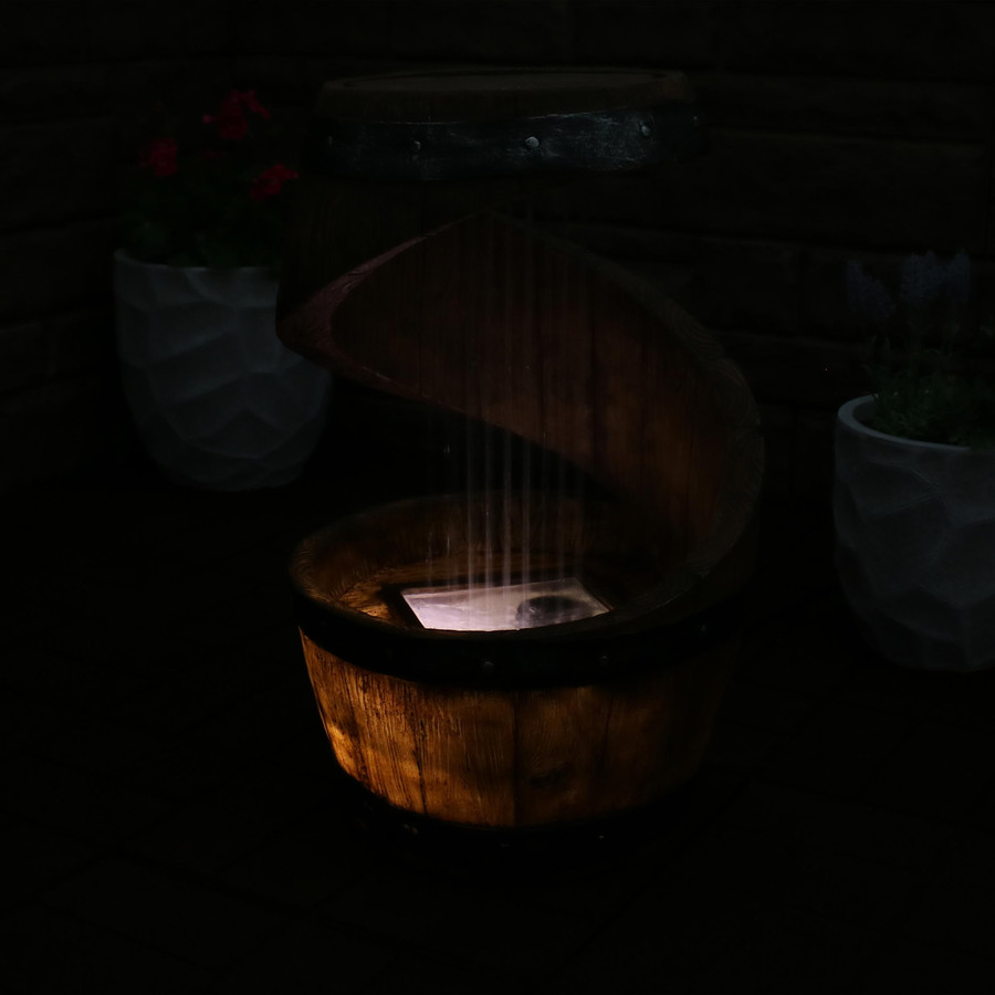 Spiraling Barrel Outdoor Water Fountain with LED Lights, Nighttime
