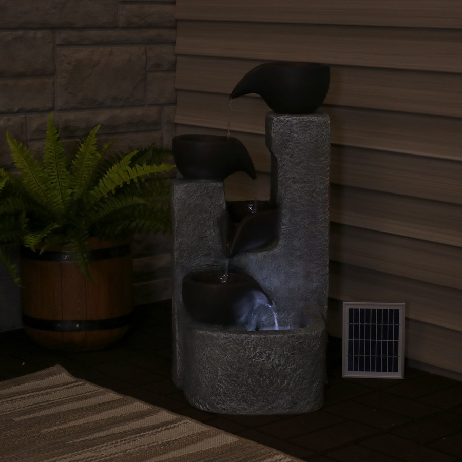 Aged Tiered Vessels Solar Fountain, Nighttime