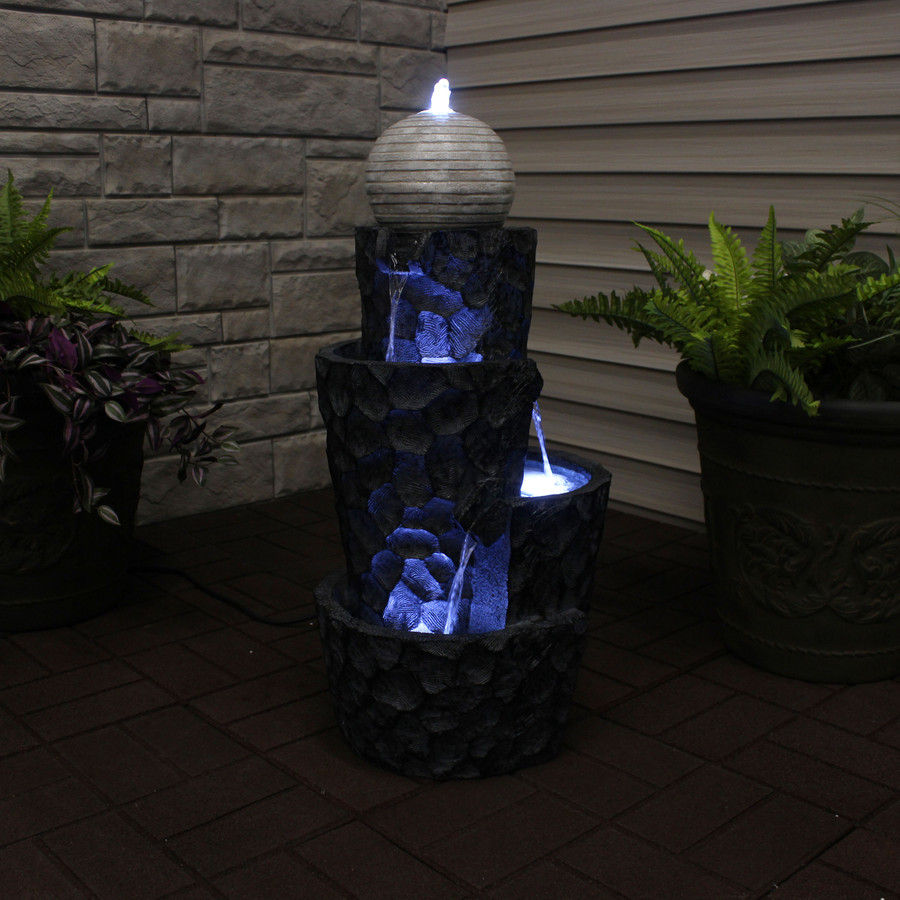 Sunnydaze Hewn Spiral Tower Outdoor Water Fountain with LED Lights and Electric Submersible Pump, 32-Inch, Nighttime