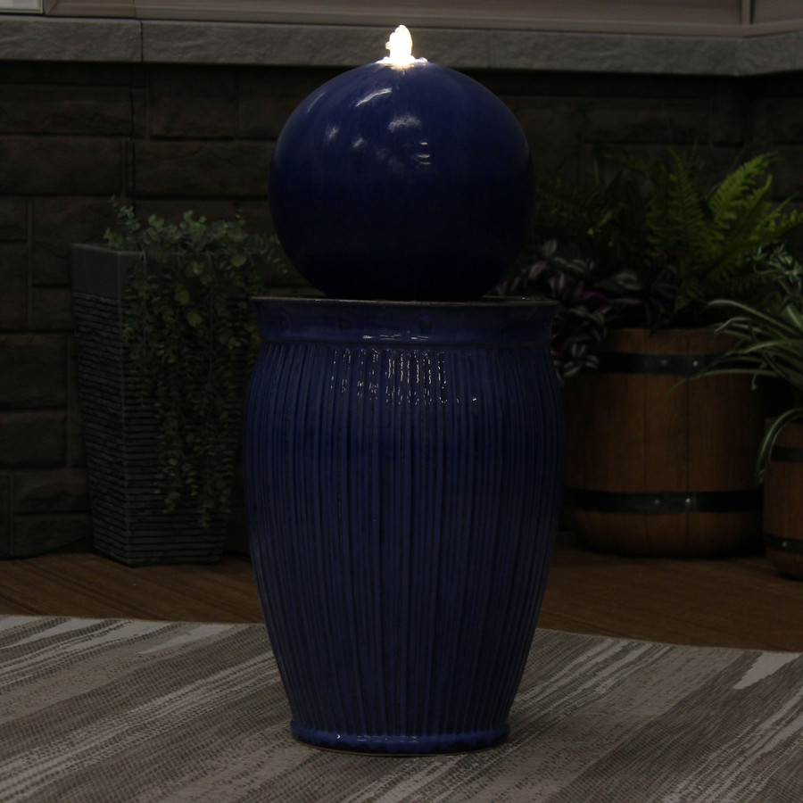 Orb on Pedestal Ceramic Outdoor Fountain, Nighttime