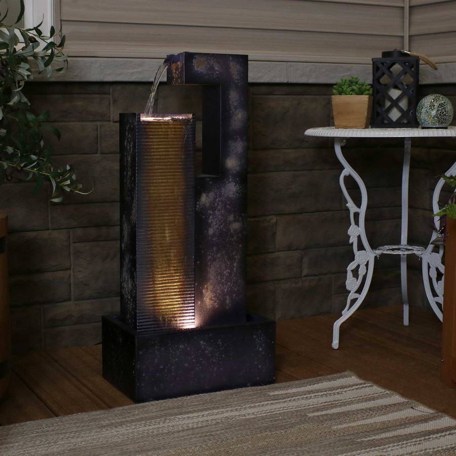 Cascading Tower Outdoor Metal Fountain, Nighttime