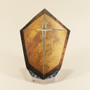 A Golden shield uniquely designed and drawn to hide the cross when turned off.
