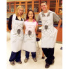 People wearing the Disposable Apron with Frog Graphic