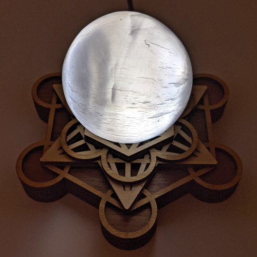 Pictured with a Selenite Sphere