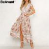BeAvant Bohemian floral print summer dress 2019 V neck ruffle sleeve beach maxi dress Vintage sash women dress sexy vestidos