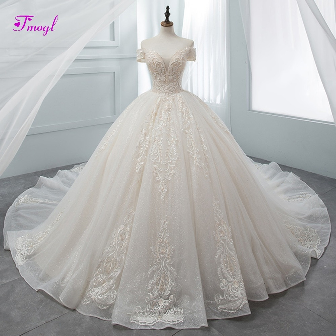 f9a6b81df02c Fmogl Gorgeous Appliques Chapel Train Ball Gown Wedding Dress 2018 Luxury  Beaded Boat Neck Princess Bridal Gown Vestido de Noiva - OnshopDeals.Com