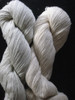 natural green cotton yarn. Scoured on the left, unwashed on right