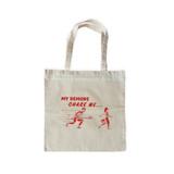 Chasing Demons Tote Bag