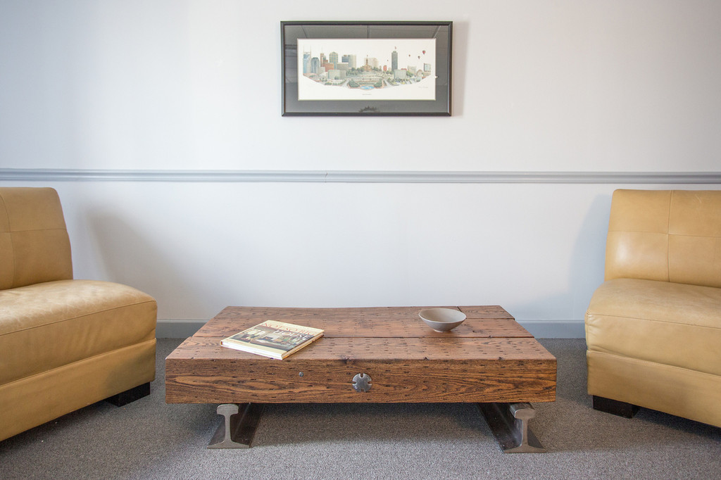 leed-certified coffee table with low profile in steel timber