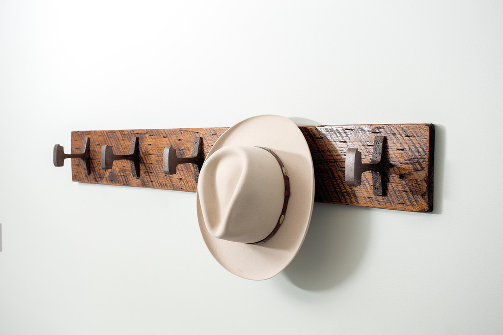 hanging steel hook hat rack on distressed reclaimed slabbed wood