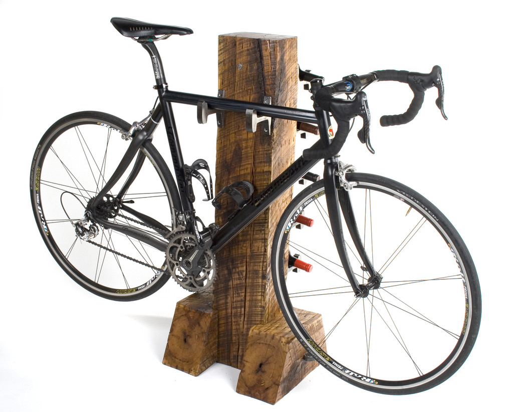 bike and wine rack with vintage iron hardware and hardwood timber post rails to trails