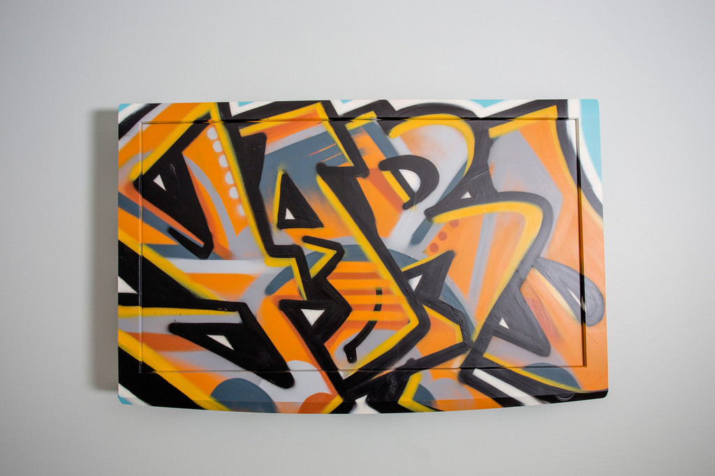 original spray painted graffiti covered wall hanging flatscreen for commercial residential or hospitality