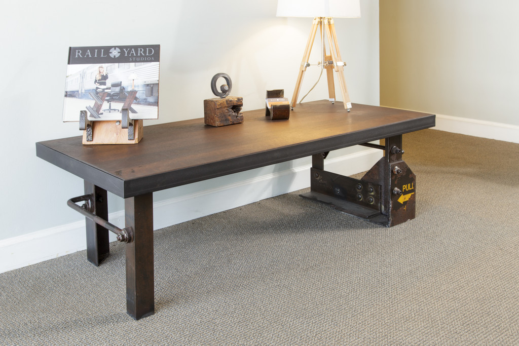 wood top coffee table with industrial style decor