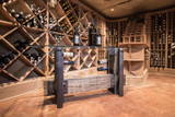wine cellar tasting table from reclaimed industrial aged wood and steel for luxury upscale homes