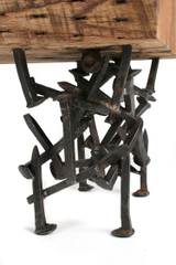 abstract ironwork bench seat legs welded scraps randomly assembled