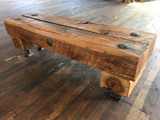 heavily distress hickory timber bench on raw hardwood floor in old renovated warehouse