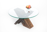 x-shaped three-legged coffee table from reclaimed steel and salvaged wood with round glass top