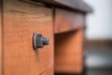 Industrial nut drawer pull handles on mahogany desk drawer