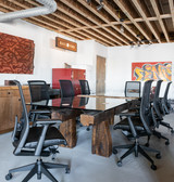Small batch repurposed fine metal patina conference table