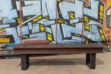 Graffiti backed railroad bench