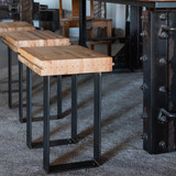 Simple wood and steel steel from reclaimed railroad boxcar flooring