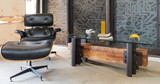 Eames armchair beside industrial modern coffee table from steel and wood timber
