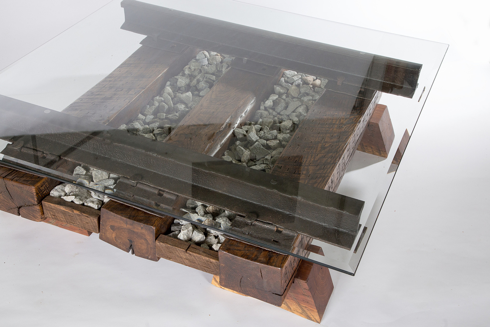 railroad track coffee table with cross ties, steel rail, and granite stone ballast