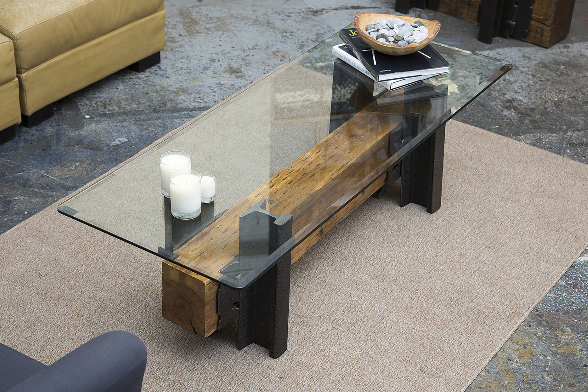 simple modern loft interior style coffee table from steel and timber with glass top