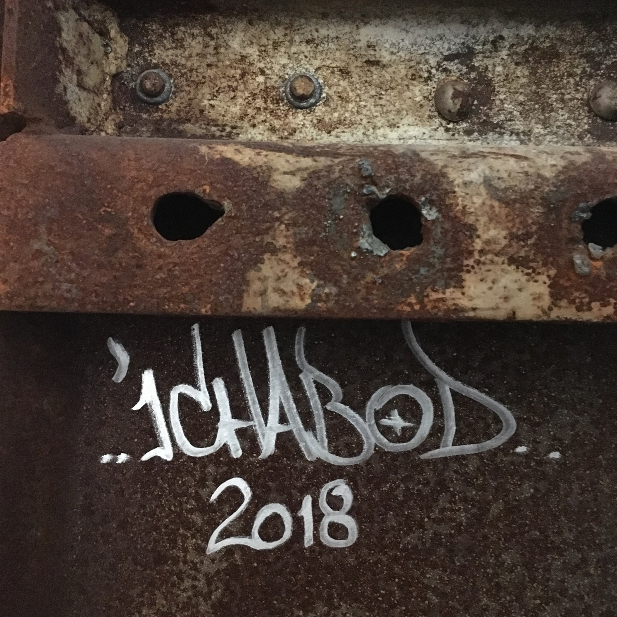 ICHABOD handstyle signature on  rusted steel