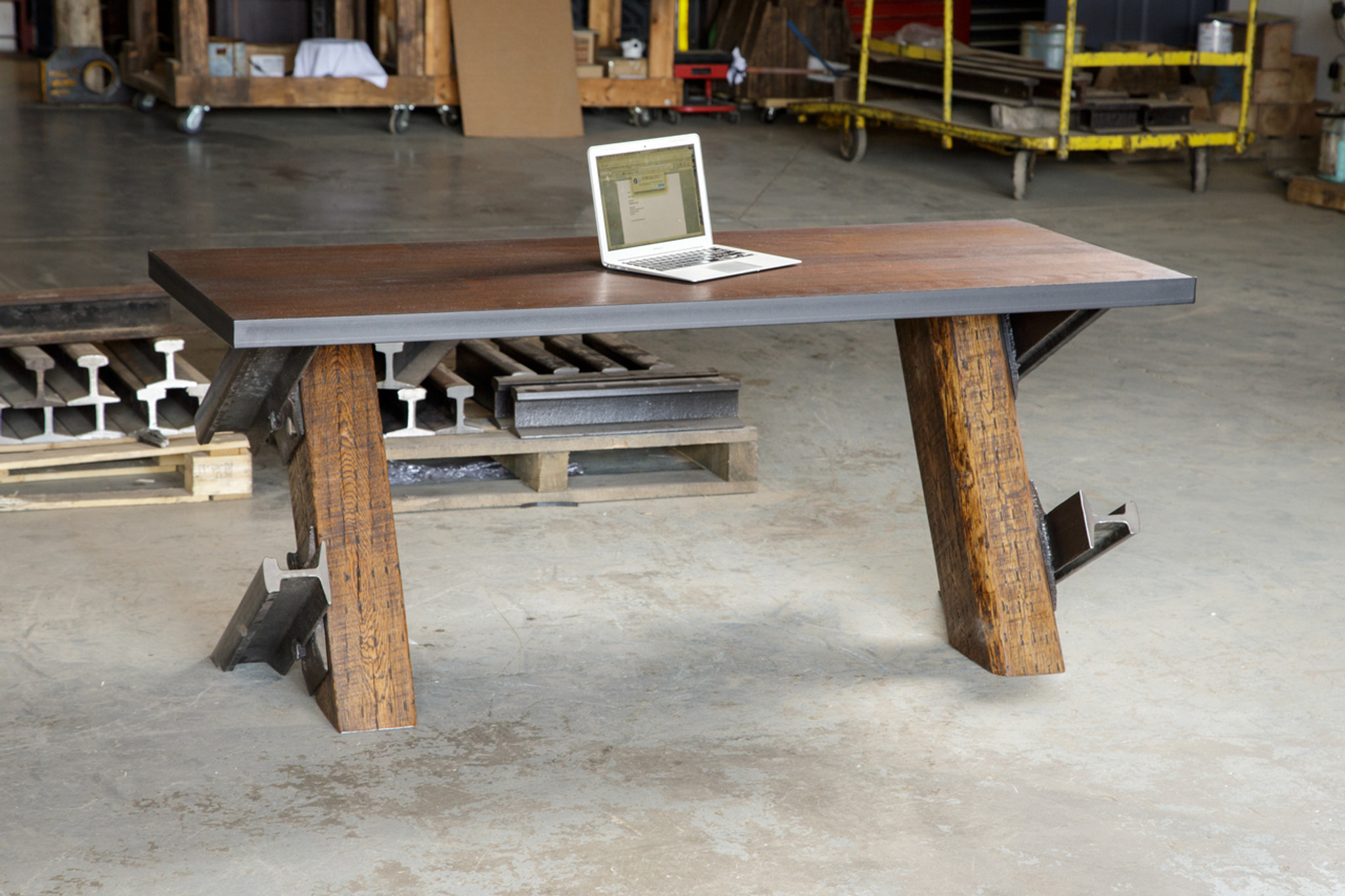 industrial interior desk with apple laptop on desktop